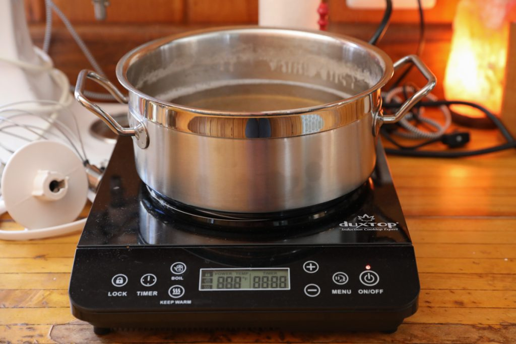 cooking down maple sap on an induction burner